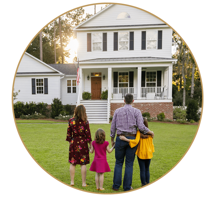 Family in front of farmhouse
