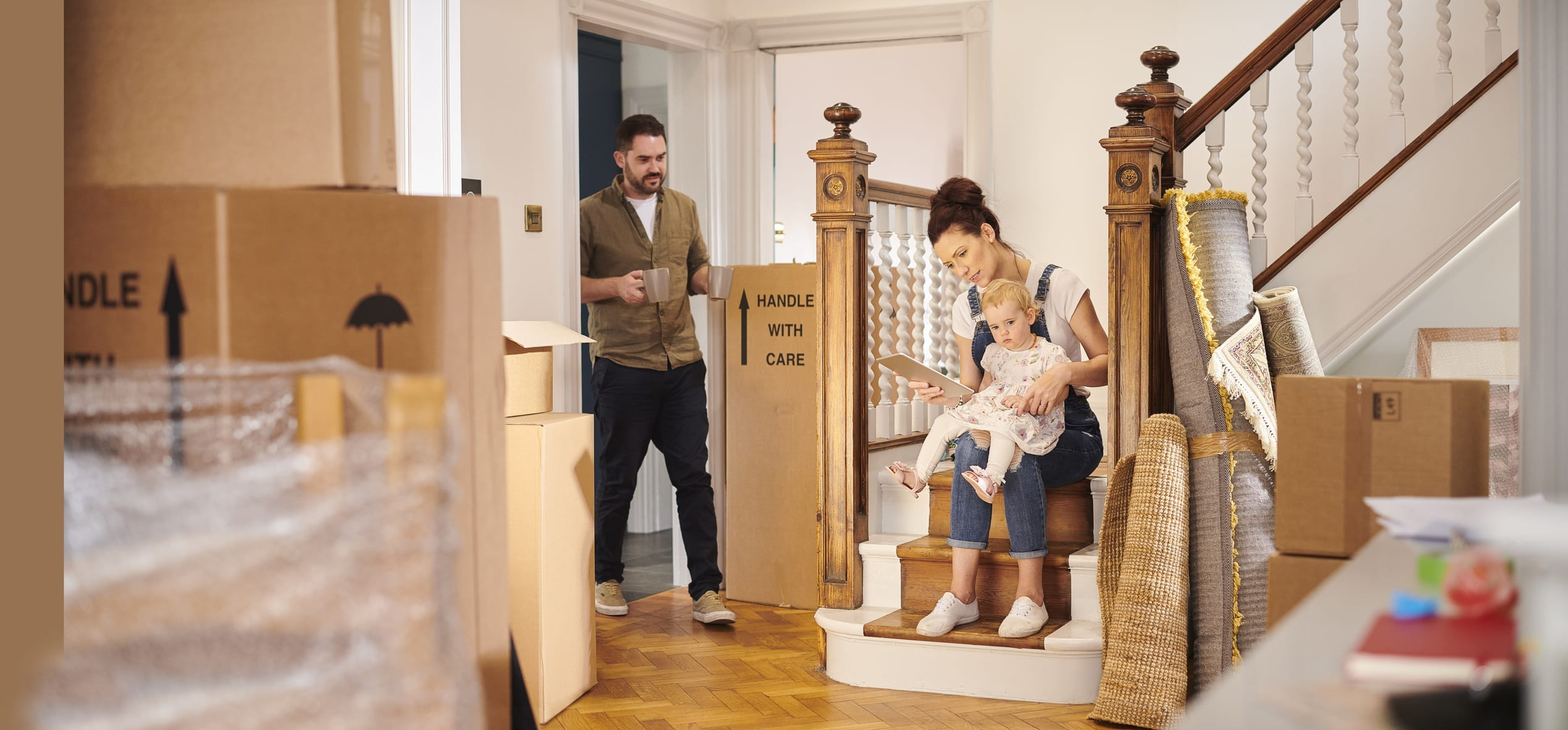 a young family move into their new home