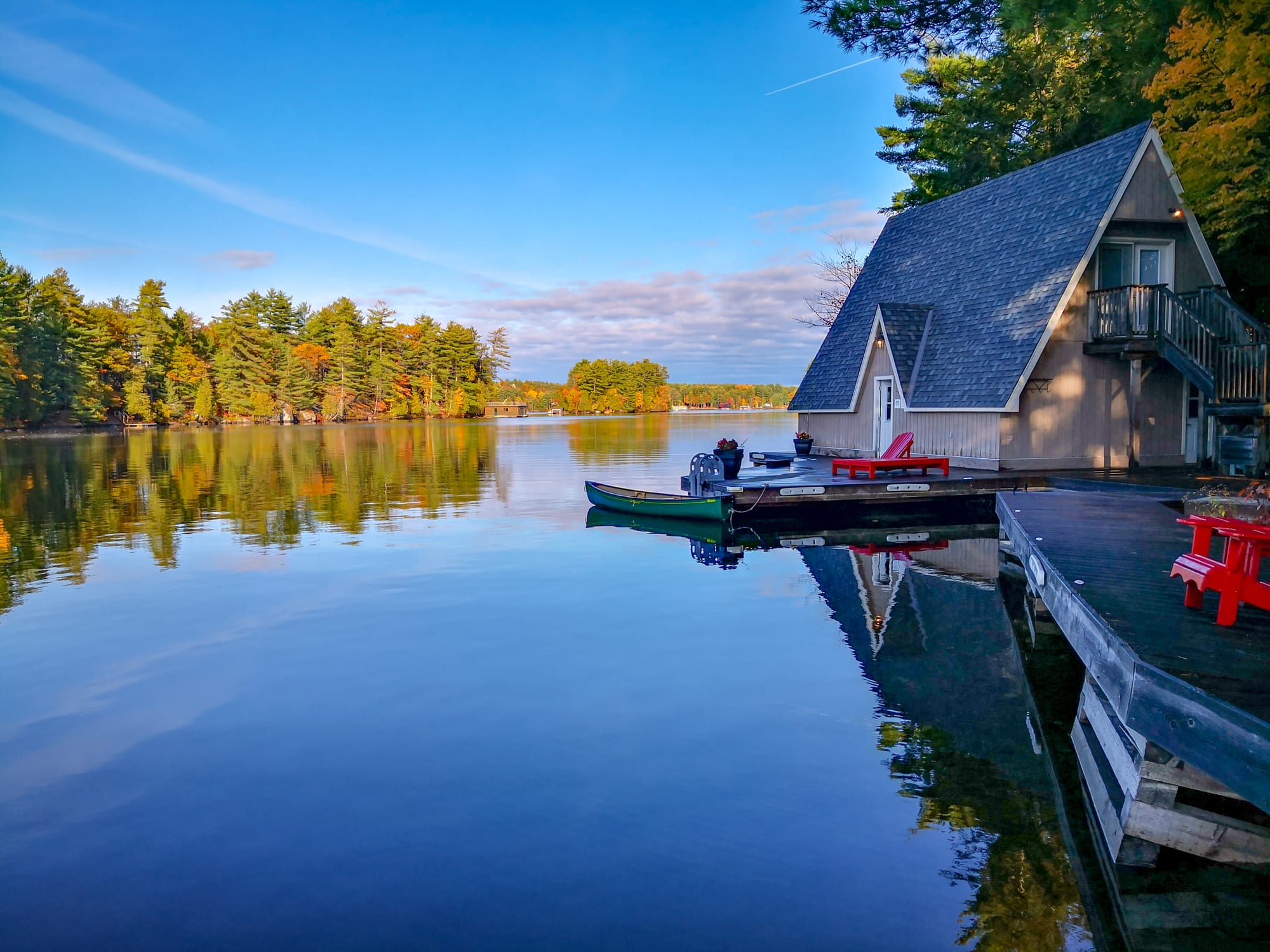 A boat house of Taylor Island in Autumn at Gravenhurst, Ontario, Canada.