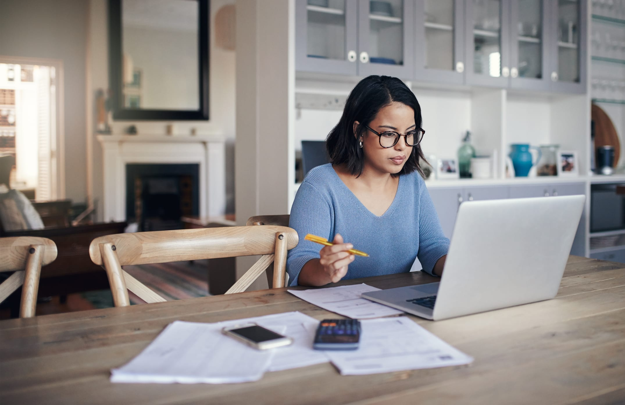 Shot of a young woman using a laptop while working from home